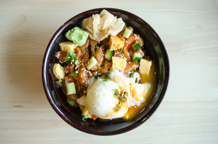 Japanese traditional dish Gyudon made from thinly sliced beef, onion, soy sauce and onsen tamago