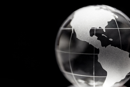 business globe: Transparent globe with black background