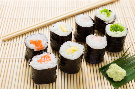 wasabi: Salmon, egg and vegetable sushi rolls with sauce and wasabi