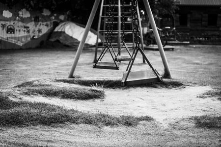 play the old park: Swing in the playground, black and white tone Stock Photo