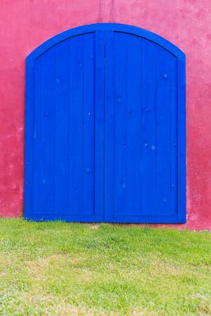 blue door: Blue door on the pink wall, background