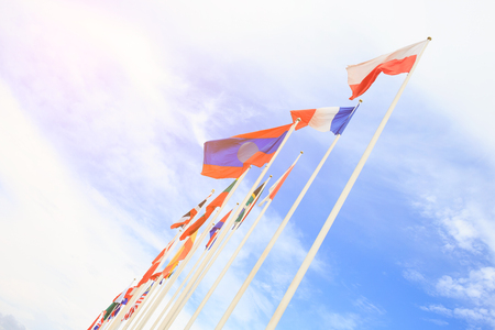 waft: Nation flags waft with blue sky