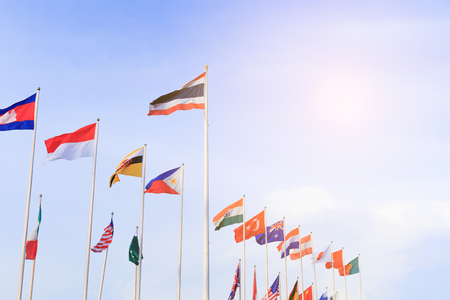 Nation flags waft with blue sky