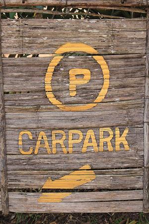 carpark: Wooden boards direct you toward the carpark Stock Photo