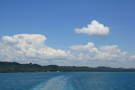Blue sky and white cloud on Water in the back of ferry Stock Photo