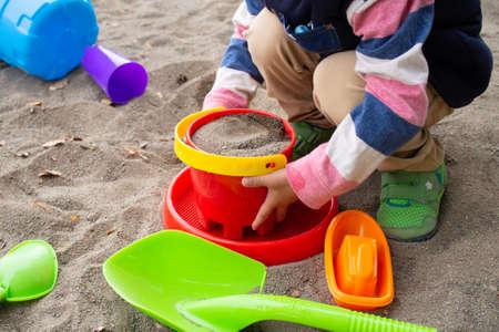 Japanese children playing in the sandbox (kindergarten children)