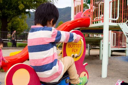 Japanese children playing in a park in Gifu (kindergarten children)