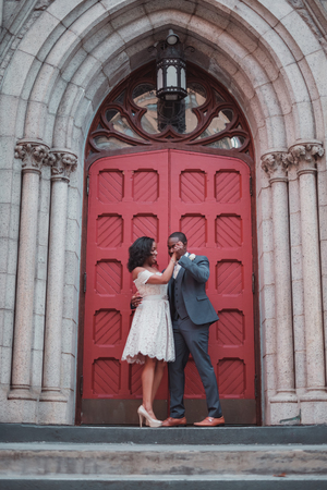 NEW YORK CITY, USA - July 10, 2018: african american just married couple outside the church Editorial