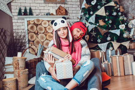guy portrait: Beautiful couple in love in Christmas decorations make the selfie