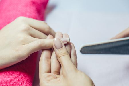 Manicure. Beauty saloon. Close-up. Remove old nail polish.