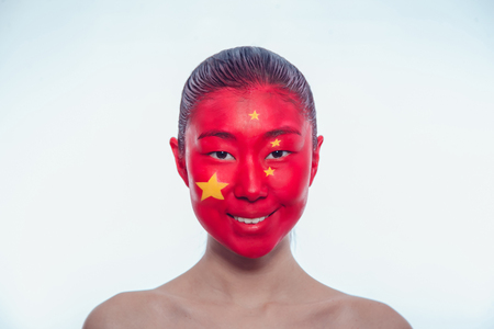 communists: Girl with a Chinese flag on the face
