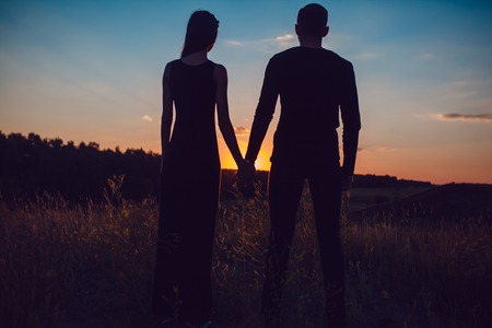a meeting with a view to marriage: The guy with the girl at sunset Stock Photo