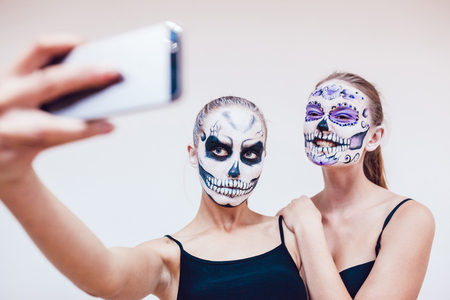 grimace: Two girls going on Halloween, grimace and make selfie Stock Photo