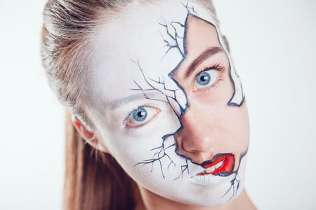 skeleton costume: Girl with Halloween face art on white background