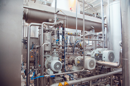 kettles: Modern beer plant, with brewing kettles, vessels, tubs and pipes made of stainless steel. Brewery.