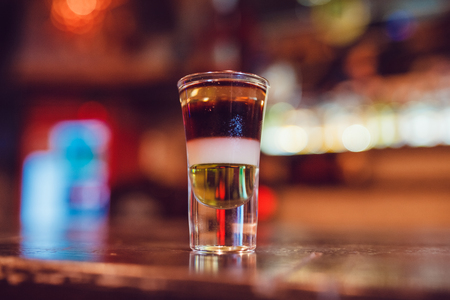 A cocktail made by layers. Shot at the bar. Stock Photo