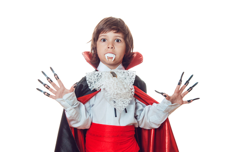 Boy in scary Halloween costumes isolated on white. Dracula.