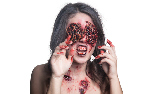 Girl with realistic sores and worms in her eyes. Creative halloween makeup. Isolated. Stock Photo