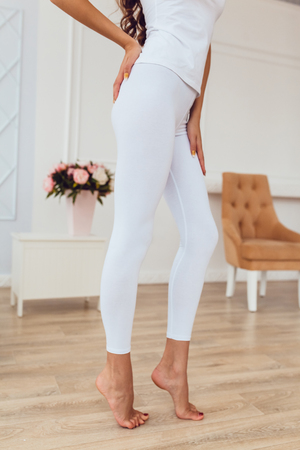 Legs of a sexy girl in white leggings. Mock-up. Stock Photo