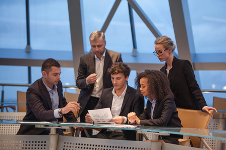 Group of business people having meeting together and conduct discussions. Stock Photo