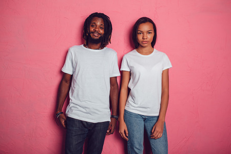 Beautiful African American couple in white t-shirts. Mock-up.