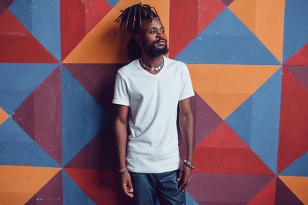 African American man with dreadlocks and a white T-shirt. Mock-up.