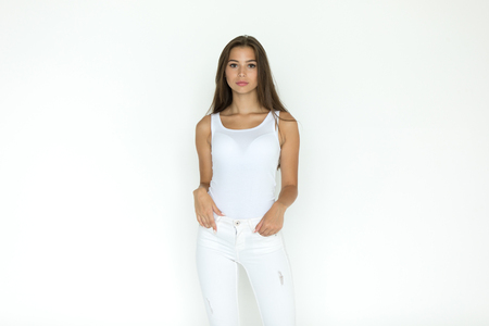Attractive young woman in blank white tank-top. Mock-up. Zdjęcie Seryjne