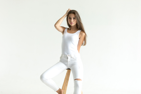 Attractive young woman in blank white tank-top. Mock-up. 스톡 콘텐츠