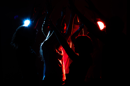 Young people are dancing. Nightlife and disco concept. Party. Imagens