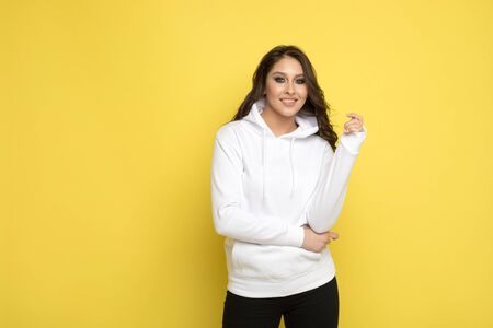 Attractive young woman in a white hoodie. Mock-up.