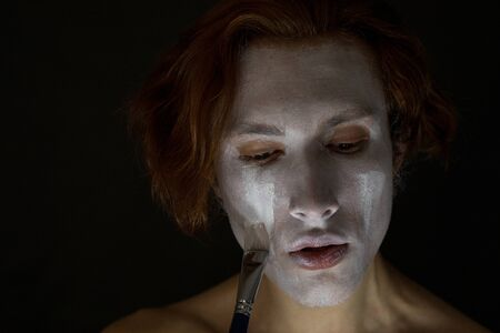 Man gets white paint on the face. Stock fotó