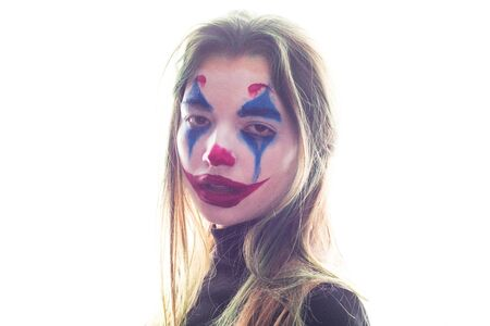 Portrait of a girl with clown makeup isolated on white background.