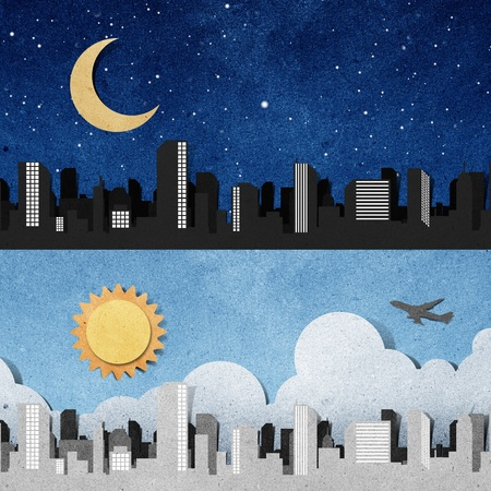 city panorama silhouettes recycled paper craft stick on white background Stock Photo