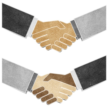 shaking hands recycled paper craft stick on white background photo