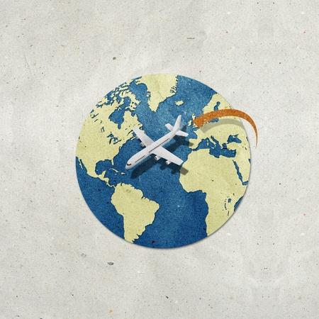airplane travel around the globe recycled paper craft Stock Photo - 9648284