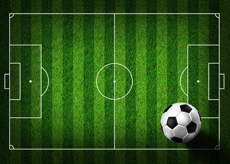 soccer background: soccer football on grass field