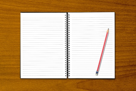 White open notebook and pencil on beech wood background. photo