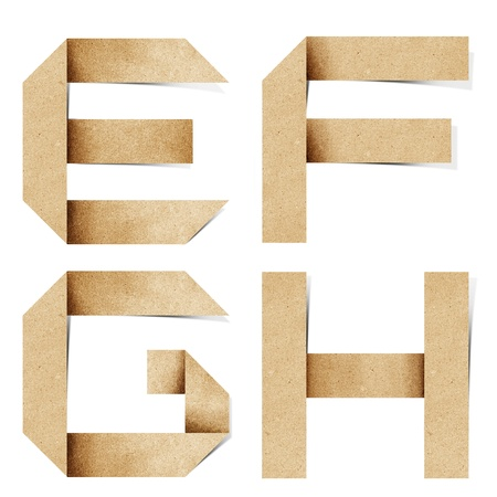 craft materials: Origami alphabet letters recycled paper craft stick on white background Stock Photo