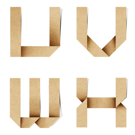 Origami alphabet letters recycled paper craft stick on white background photo