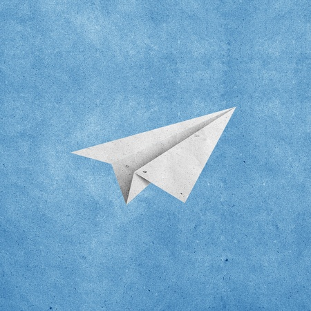 paper airplane: aircraft  recycled paper on grunge blue sky paper background