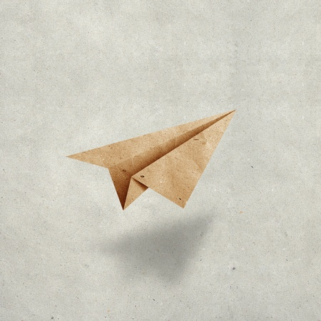 craft materials: aircraft  recycled paper on grunge  paper background Stock Photo