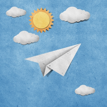 and craft materials: aircraft  recycled paper on grunge blue sky paper background