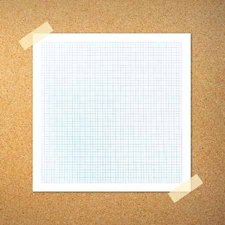 graph paper on cork board photo