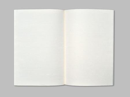 Blank notebook on middle gray background. photo