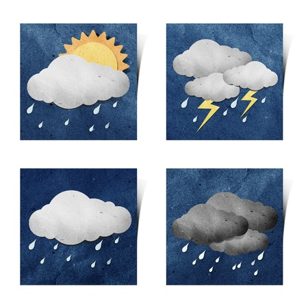 Weather recycled paper craft stick on grunge paper background photo