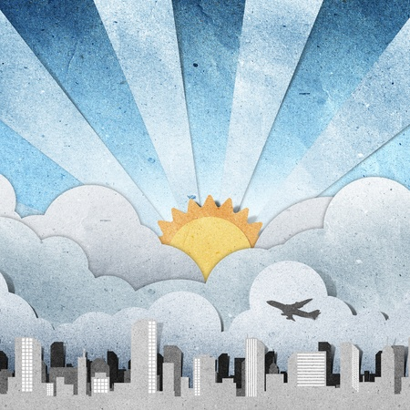 sunset and sunrise city panorama silhouettes recycled paper craft  Stock Photo