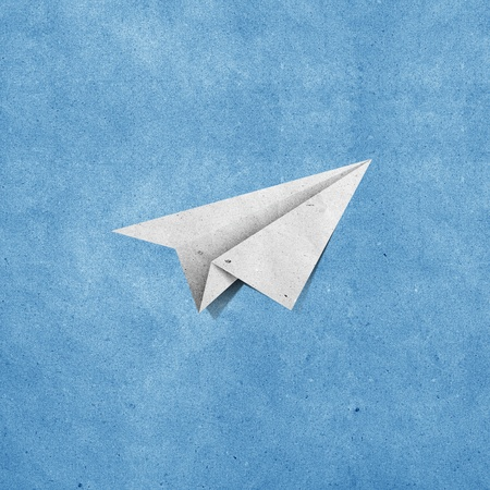 sticky paper: aircraft recycled paper on grunge blue sky paper background Stock Photo