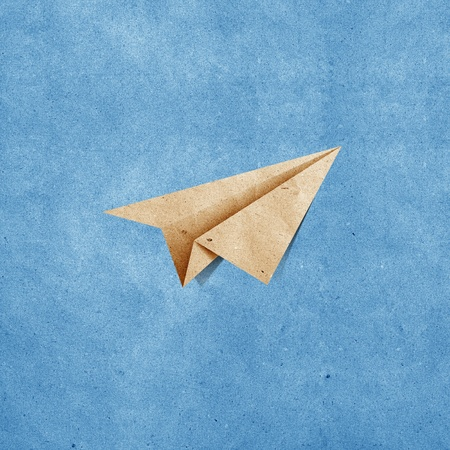 aircraft recycled paper on grunge blue sky paper background photo