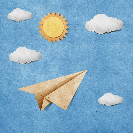 recycled paper: aircraft recycled paper on grunge blue sky paper background Stock Photo