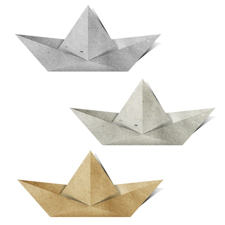 recycled paper: origami paper boat recycled paper craft stick on white background Stock Photo